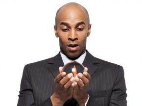 Businessman-holding-a-crystal-ball